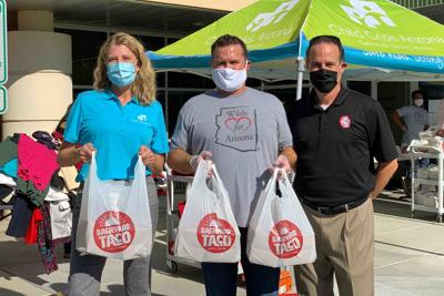 Child Crisis Center CEO Torrie Taj, Wilde Wealth founder Trevor Wilde and Backyard Tacos operations director Jesse Schwarz
