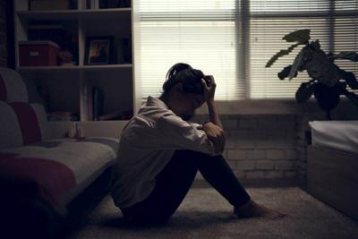 Business woman is depressed. She felt stressed and alone in the house.