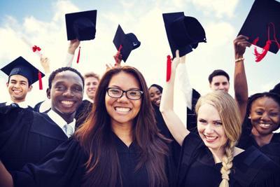 27154810 - group of diverse international students celebrating graduation