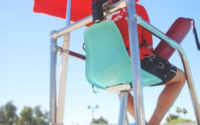 Lifeguards watch for trouble in the water. In Chandler and Gilbert last year, all seven drowning victims were adults.