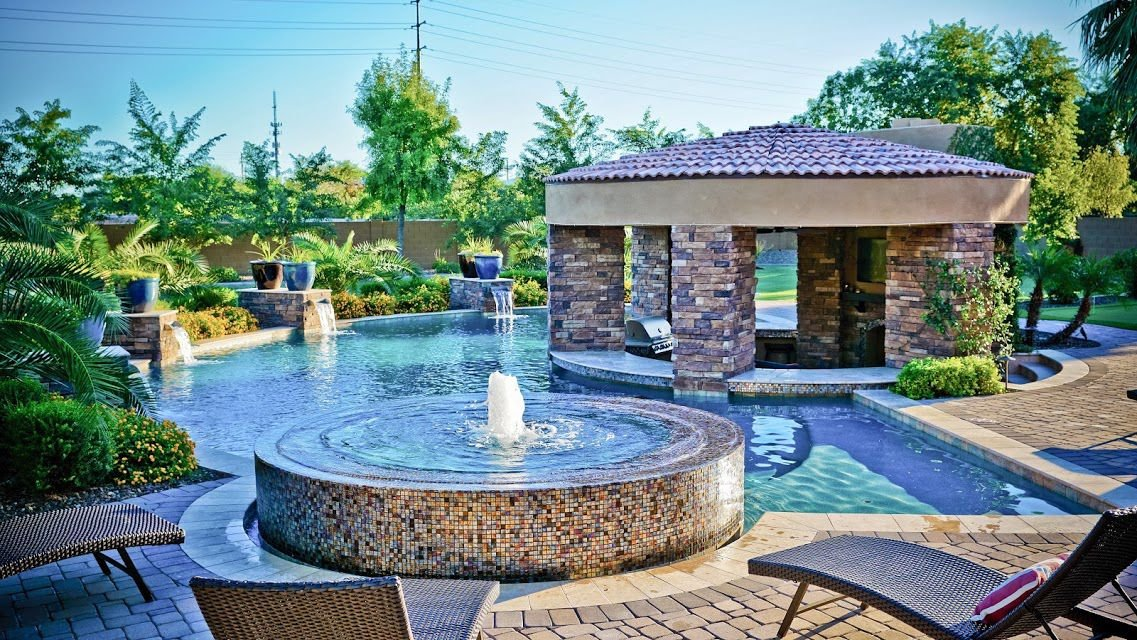 Swimming pool trends make backyards sparkle east valley for Fancy swimming pool designs