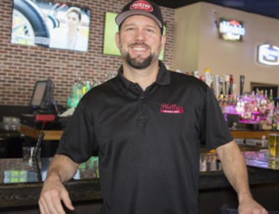 Barry Clark has put televisions on most tables at his Philly's restaurant in Ahwatukee.