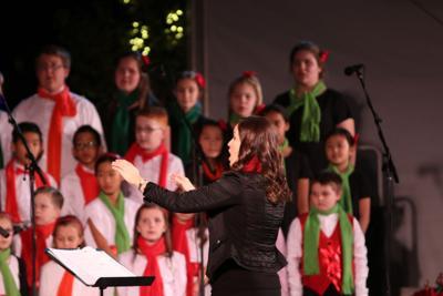 Founder Aimee Stewart conducts the Chandler Children's Choir in their winter concert.