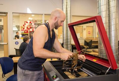 Nick Scott of Gilbert, an engineer, makes touchscreen module components at TechShop in Chandler.