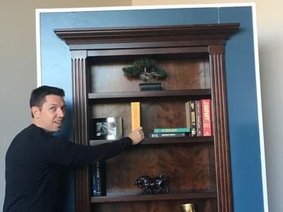 Steve Humble, founder of Creative Home Engineering, shows that this bookcase has a switch hidden in a Harry Potter book.