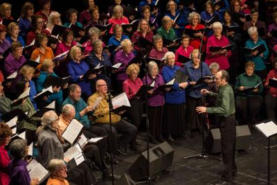 Choir director Cary Burns said the 140-member choir will use holiday songs to underscore a theme of togetherness.