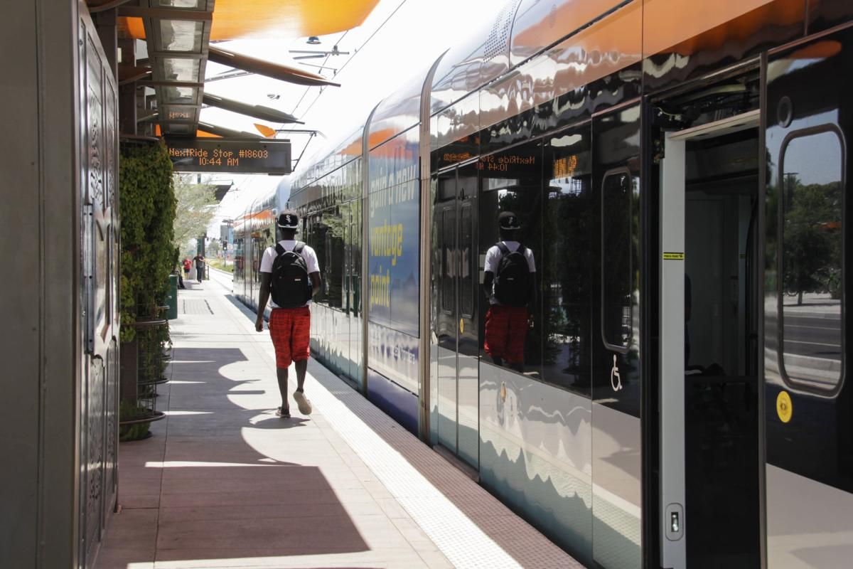 A lone passenger debarks at the light rail stop at Mesa Drive, currently the eastern end of the line. Valley Metro and Mesa officials hope to extend the light rail to Gilbert Road.