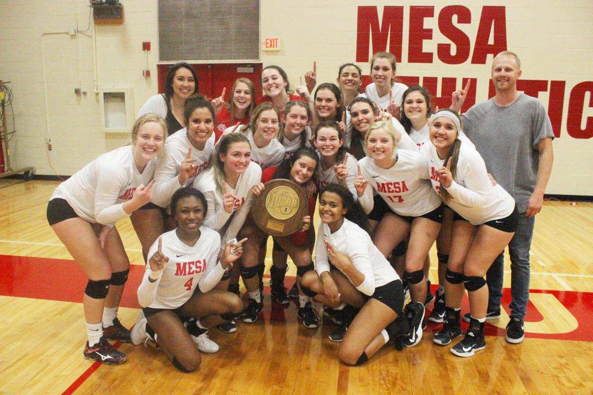 The Mesa Community College volleyball team celebrates with the ACCAC Region I Division II championship trophy. The team now heads to the NJCAA National Tournament in Charleston, West Virginia.