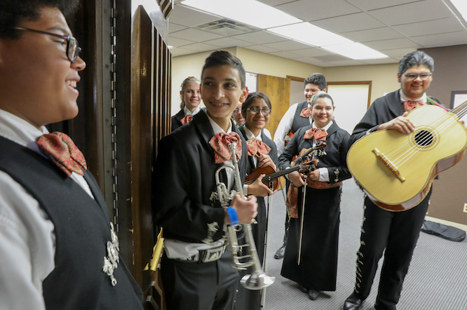 Students from Mariachi Sones del Desierto get ready to perform at the group's ribbon-cutting and open house in Mesa
