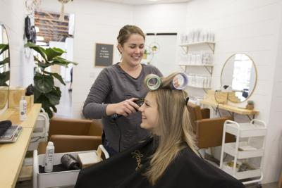 Maddie Obray with Hainsworth Co. does Lily Petite's hair. The salon is one of several beauty businesses at the Palette Collective at Chandler Village.