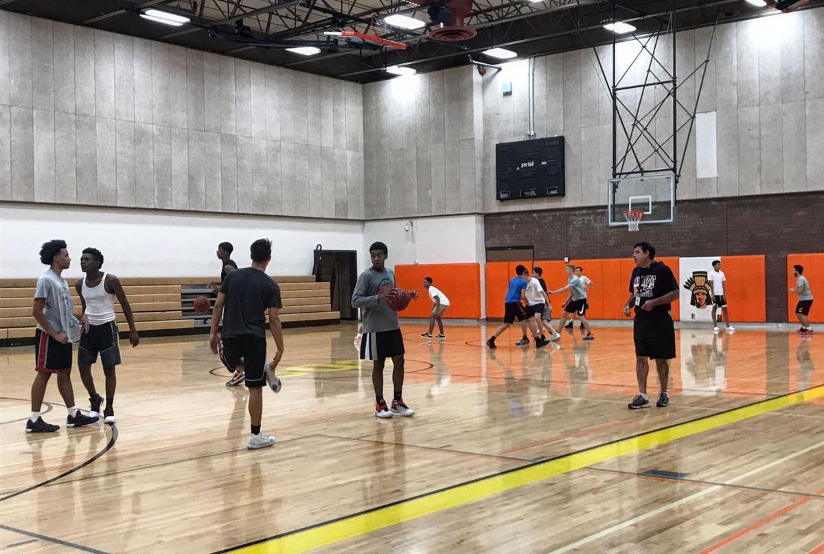 The Corona del Sol boys basketball team at practice