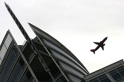 A Southwest Airlines plane flies over Tempe Town Lake and Hayden Ferry's Lakeside center in Tempe in December 2008.