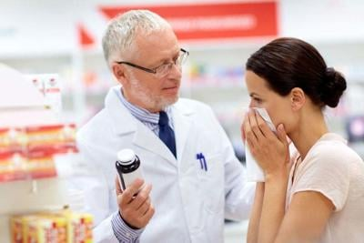 apothecary and sick customer at pharmacy
