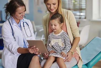 Doctor showing results on the tablet