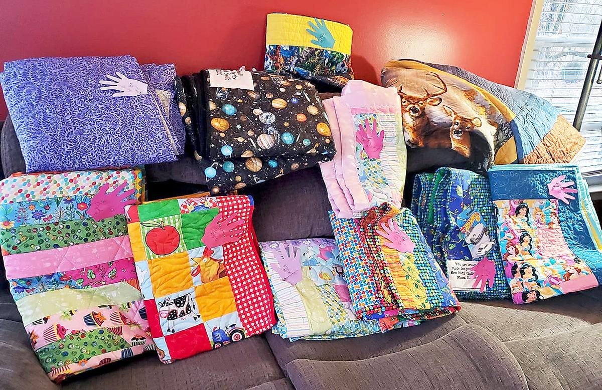 Flora guild makes quilts for area foster children