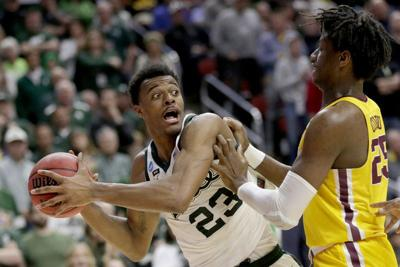 Michigan St's Tillman forced to grow up fast on, off court