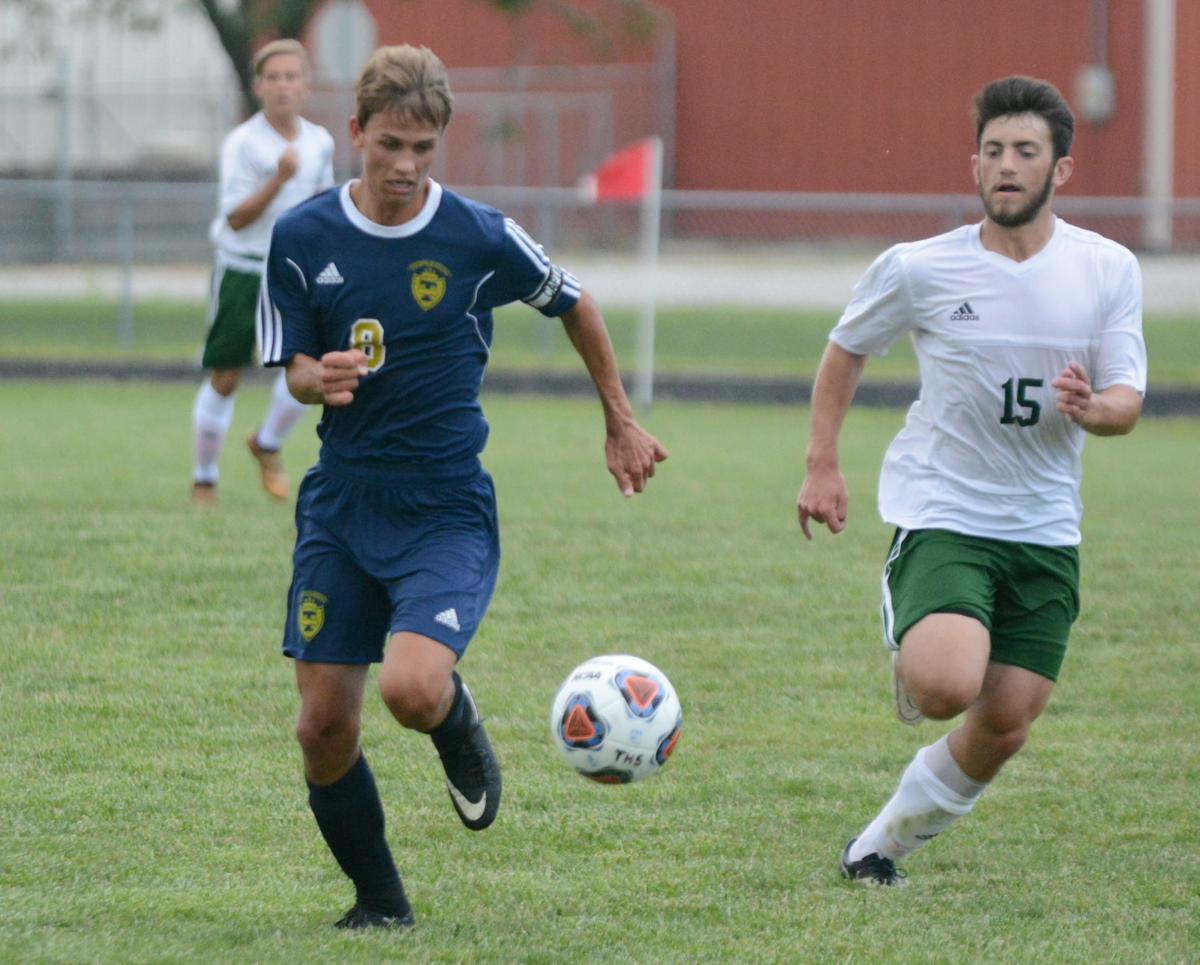 b8f1544ca Teutopolis  Jarrett Hardiek races with the Mattoon defender for position on the  ball in the team s 3-0 loss to Mattoon in the season opener.