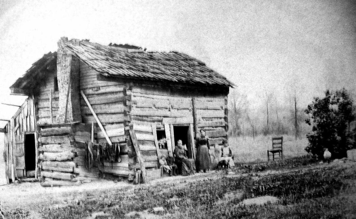 Fitch family in front of log cabin- black and white.jpg