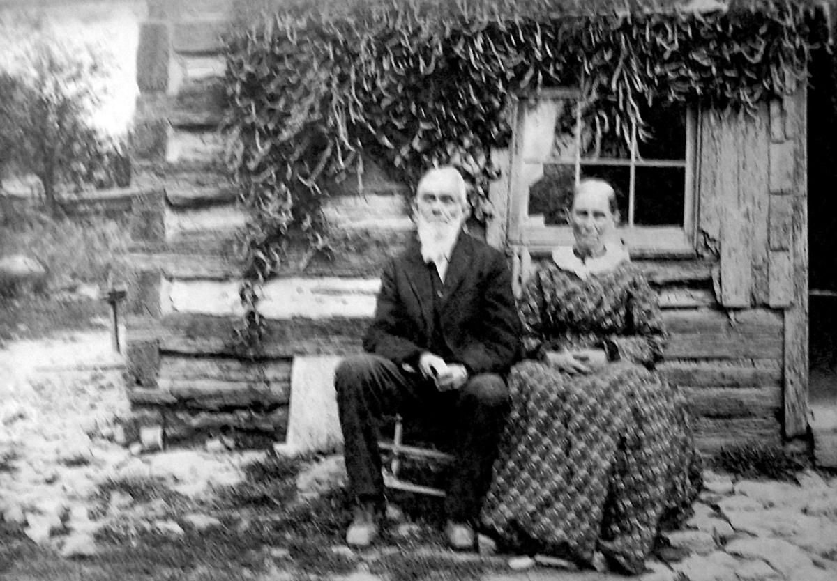 Needs to run-Fitch couple in front of log cabin-2.jpg