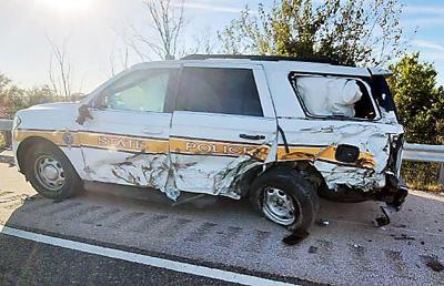 Squad car struck by semi in St. Elmo
