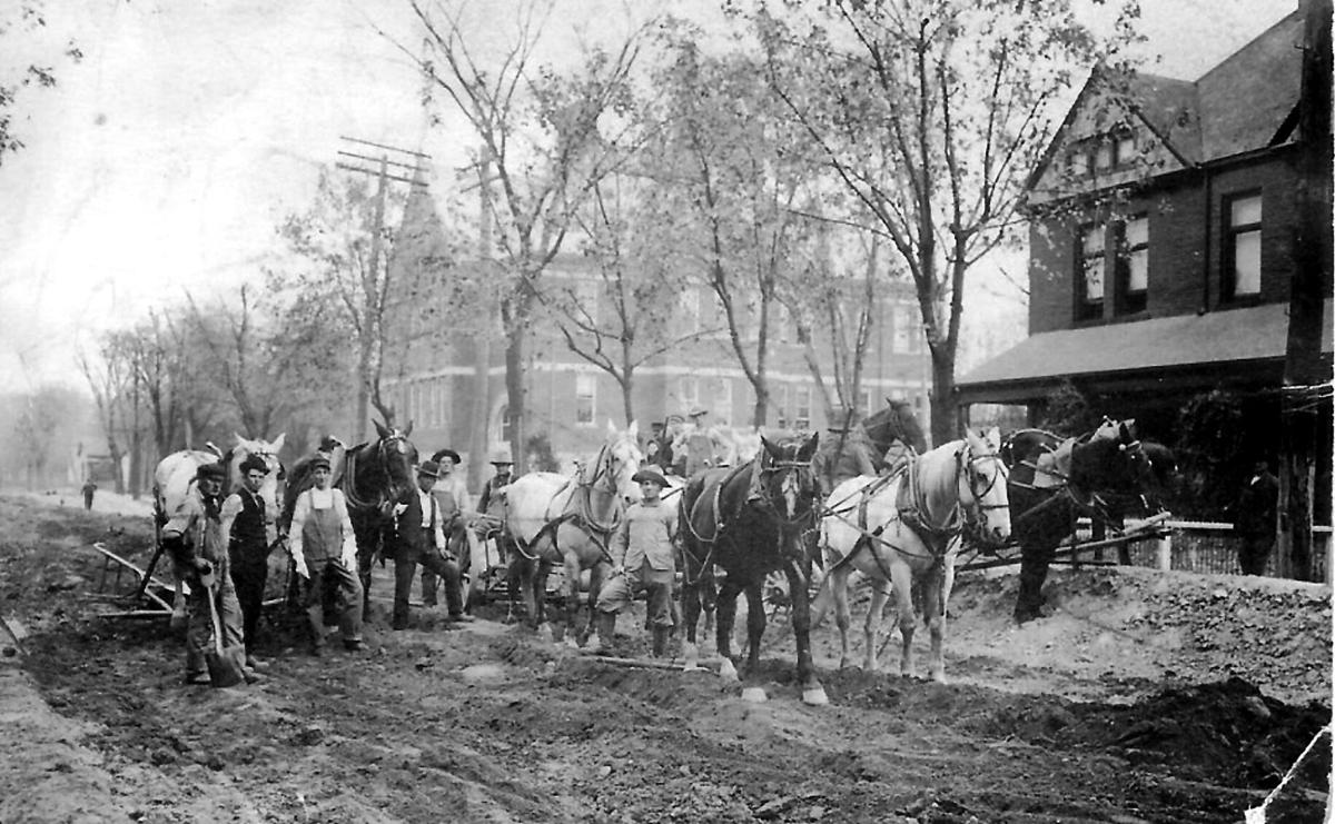 Effingham working on the Fayette Street and David B. Crews Home on right.jpg