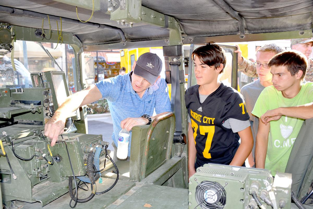Kids learn about a military Humvee