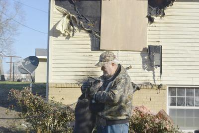 Dog saves owner from burning house