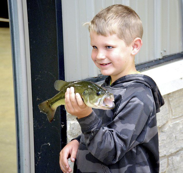 Kids catch fish and time with dad