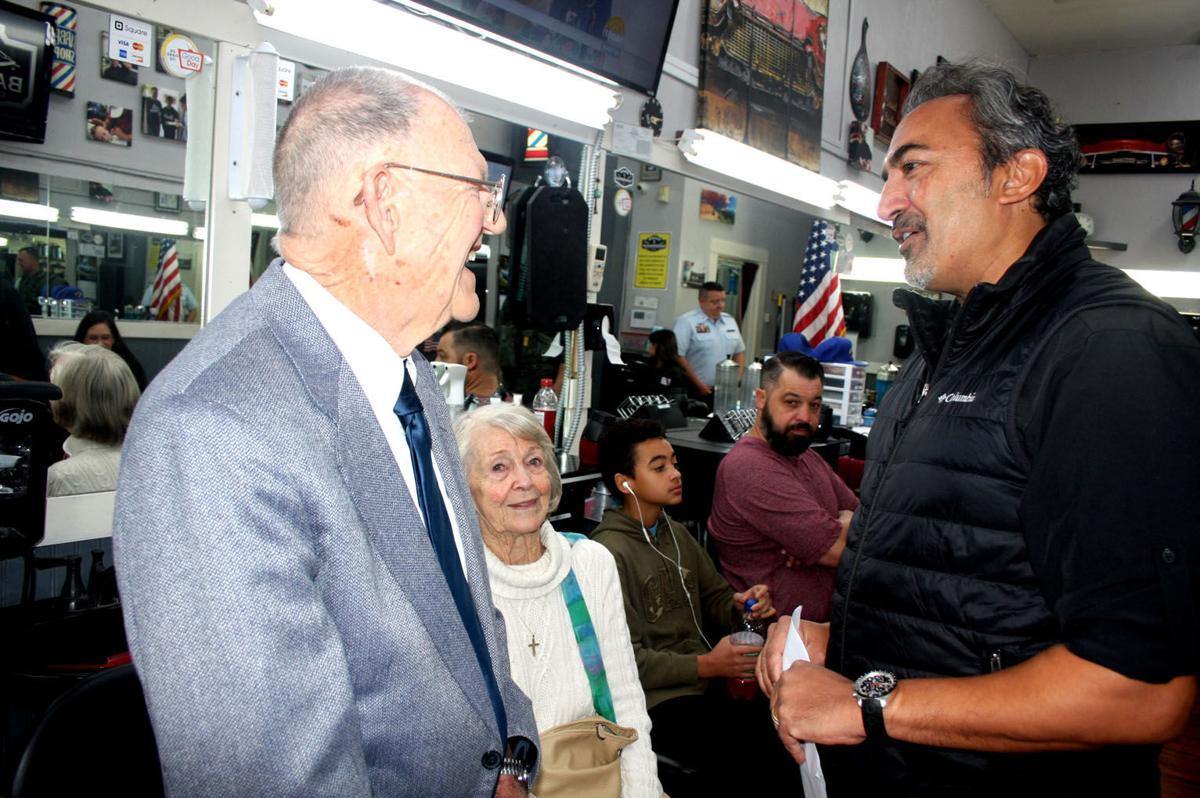 Glen Stout, left, enjoys a conversation with U.S. Rep. Ami Bera