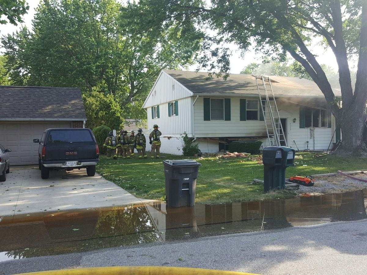 Explosion heard before Elkhart home erupts in flames; dog and cat inside survive