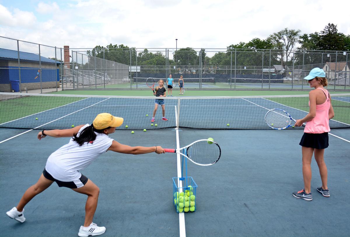 Players getting their swings in during Elkhart's summer tennis program