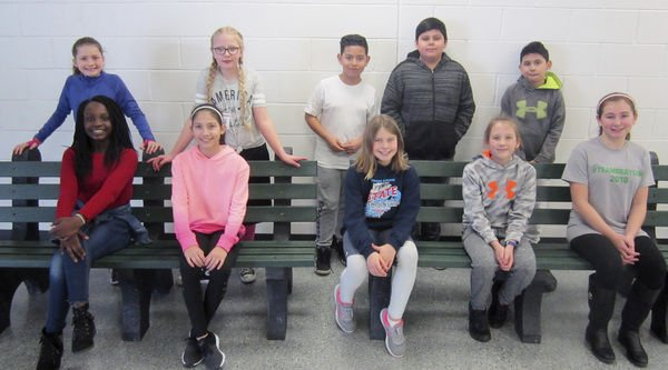 Students, staff collect plastic caps to make benches