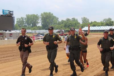 Law enforcement officers send message at Fair 5,000