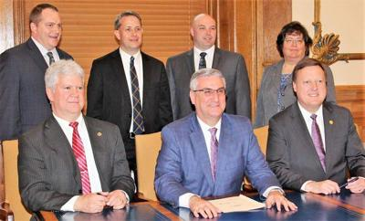 Governor signs out of state criminal history bill