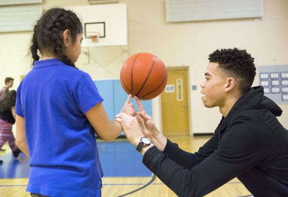 Goshen basketball players spend time with elementary school students