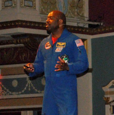 Students urged to aim high by astronaut, NFL player
