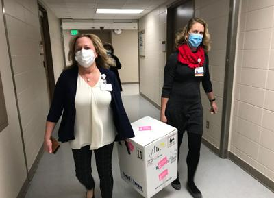 COVID-19 vaccine arrives at Elkhart General, Rose Speights and Michelle Bache