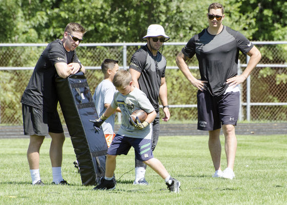 NFL players teach Elkhart campers, and speak to football's dangers