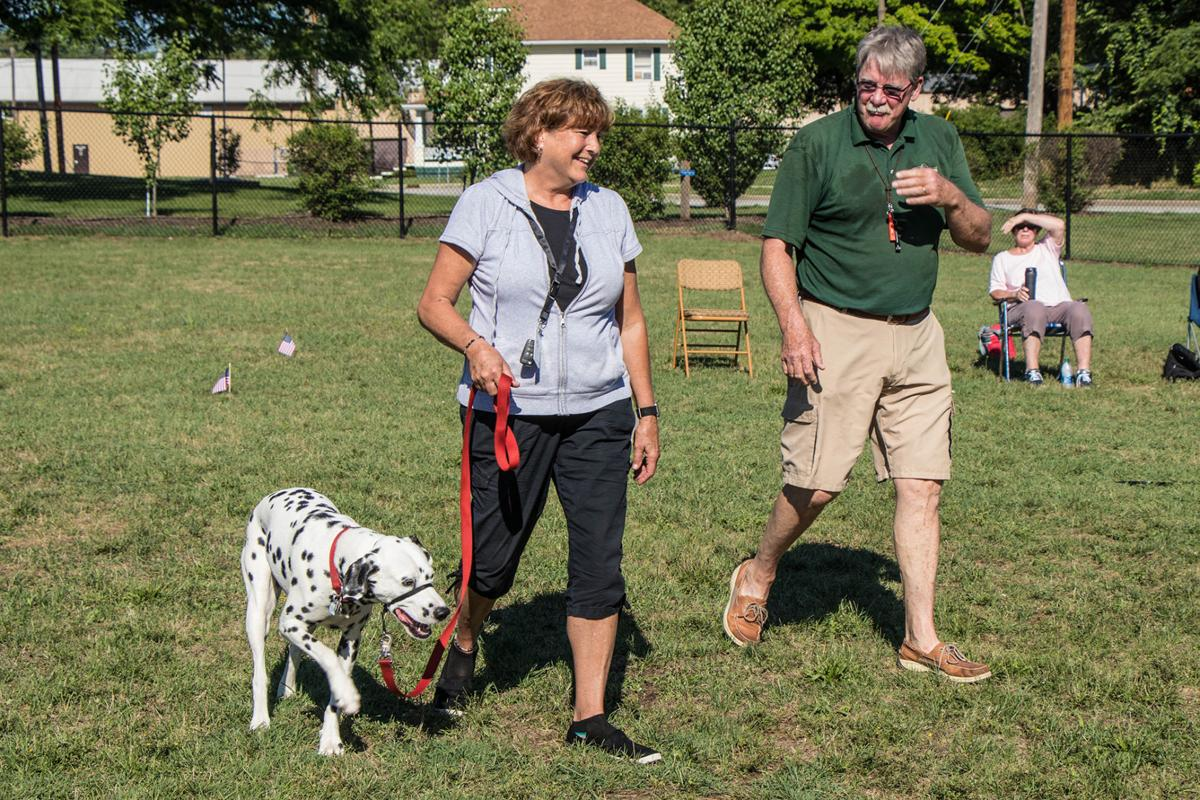 Sue Koontz at the dog park with John Faigh