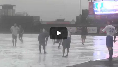 South Bend Cubs slip 'n' slide in the rain at Four Winds Field