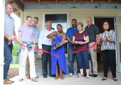 Family cuts ribbon on Habitat home