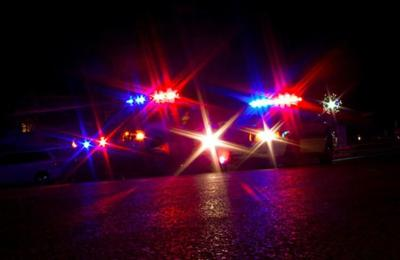 Pickup hits utility pole, flips
