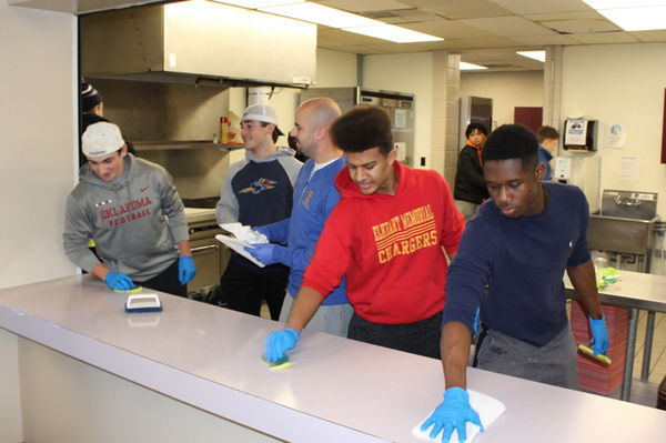 Combined football squad bonds by volunteering