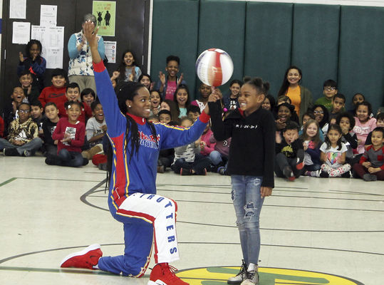 Globetrotter bounces message to students