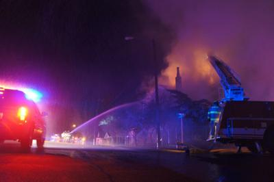 Fire caves in roof of Pine Street home