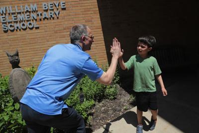 Beye Elementary school principal Jonathon Ellwanger with student Matias Best, 6, outside the school in Oak Park, Ill. on June, 7, 2019.
