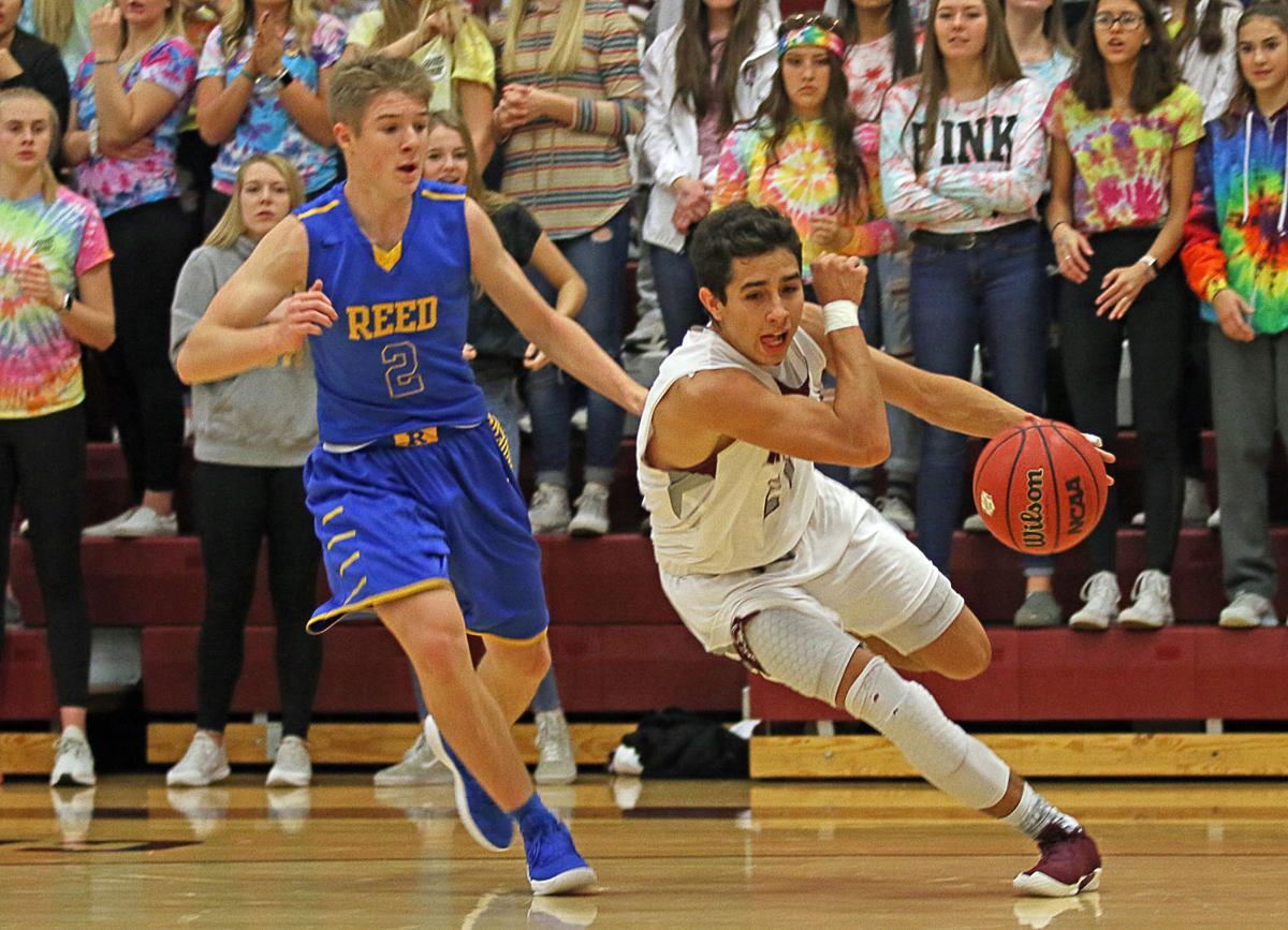 Eko S Alex Klekas Right Drives Baseline Saay For Two Of His High 24 Points And A 55 54 Lead Against Reed At Centennial Gymnasium
