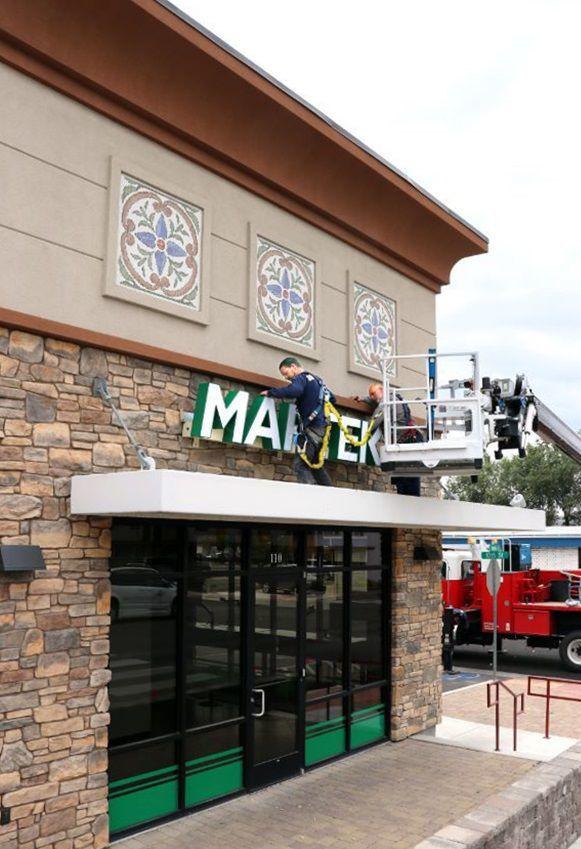 Maptek - Puttling up signs