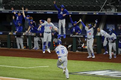APTOPIX NLCS Dodgers Braves Baseball