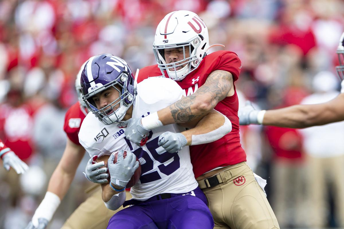 Wisconsin Badgers linebacker Zack Baun (56) tackles Northwestern Wildcats running back Isaiah Bowser (25) on Sept. 28, 2019 at Camp Randall Stadium in Madison, Wis.